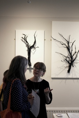 Lauren chats to a visitor during the preview event of 'Permian', a solo exhibition by Lauren Dawson at Haptik Gallery, 2018